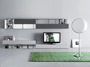 E' sempre importante un tocco di colore il contrasto cromatico e materico. In questo caso elemento di finitura importante è il tappeto verde in un interno in cui dominano colori chiari.