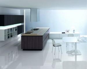 Aura in un ambiente open space propone continuità tra zona cucina e zona pranzo. (Ego Design)