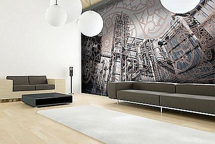 Soggiorno dalle tinte grige dove il punto focale e rappresentato dalla parete-tesa-stampata e dalle forme minimali del divano.