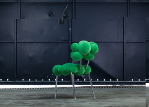 green-chair-without-arms-made-of-upholstered-on-the-seat-and-back-and-steel-on-the-legs